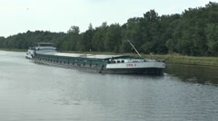 The river barge Erik V cruising along the Maas - Scheldt Canal, Belgium. - stock footage