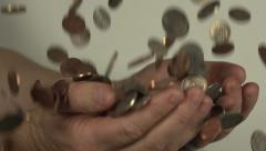 Coins drop into a pair of hands. Stock Footage