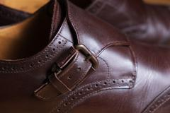 Buckle detail of a pair of classic brown Brogue shoes Stock Photos