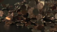 Coins drop on to a table. Stock Footage