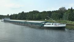 The river barge Erik V cruising along the Maas - Scheldt Canal, Belgium. Stock Footage