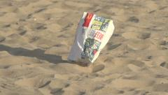 Litter on a beach - stock footage