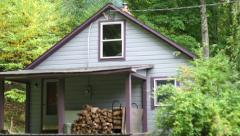 A cottage in the woods - stock footage