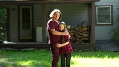 A tween girl and father in front of their home Stock Footage