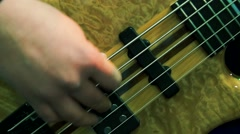 Right hand plays the bass guitar Stock Footage