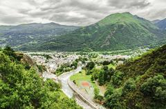 clean cityscape below the pyrenees mountains in France - stock photo