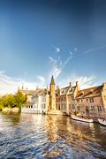houses by the water in brugge, belgium - stock photo