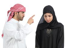 Arab couple with a man arguing to his wife Stock Photos