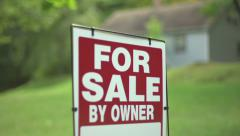 For Sale by Owner sign in front of cute rural cottage Stock Footage