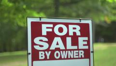 For Sale by Owner sign swaying in wind Stock Footage