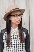 Pretty hipster posing for camera - stock photo