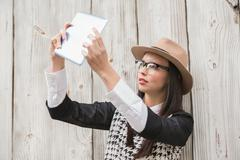 Pretty hipster using tablet pc - stock photo