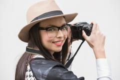Pretty hipster taking a photo - stock photo