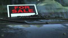 For Sale sign in a car window - dolly reveal Stock Footage