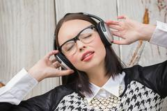 Pretty hipster listening to music - stock photo