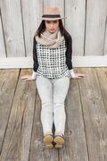 Pretty hipster sitting on ground - stock photo