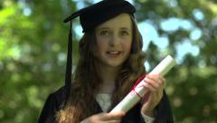 A tween girl imagines graduating Stock Footage