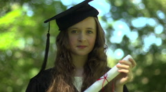 Portrait: A tween girl imagines graduating Stock Footage