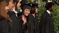 Racially-diverse students celebrate at graduation - slow motion Stock Footage