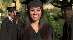 An Asian graduation student smiles and dances - slow motion Stock Footage