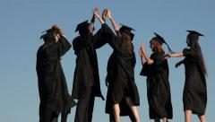 Racially-diverse students high-five their success - slow motion Stock Footage