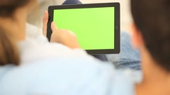 couple websurfing on internet with tablet - stock footage