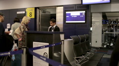 air travelers boarding airplane flight at gate at JFK airport, boarding pass - stock footage