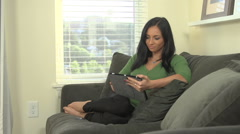 Woman holding digital tablet Stock Footage