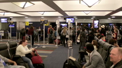 Air travelers sitting in seating area at gate at JFK airport Stock Footage