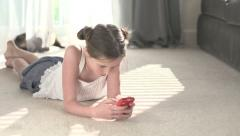 A young girl concentrates on a cell phone. Stock Footage