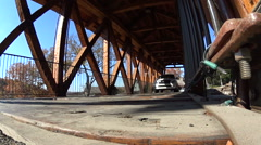 Low angle of SUV going on a covered bridge Stock Footage