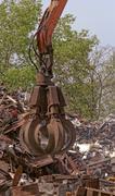 scrap metal grapple - stock photo