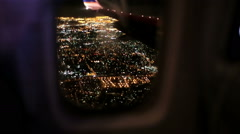 Airplane Window Seat View of Los Angeles at Night with Wing of Plane on Flight Stock Footage
