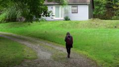 A tween girl walks home alone Stock Footage