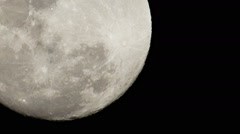 Full moon at night - Real time - Shine moon - Telephoto closeup - stock footage