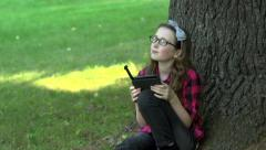 A girl reading an electronic book Stock Footage