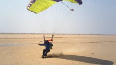 Unidentifiable skydiver lands in Swakopmund, Namibia, Africa. Stock Footage