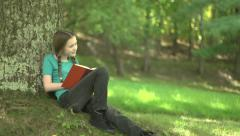 A girl imagining the story she's reading - stock footage