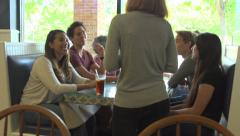 A group of friends order dinner together. Stock Footage
