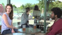 An interracial couple, outside a restaurant, order dinner. - stock footage
