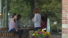 A waitress approaches an interracial couple. - stock footage
