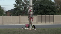 Traffic rushes past a road accident memorial - time lapse - stock footage