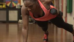 Strenuous exercise - a black women in the gym with weights - stock footage
