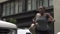 An African American crossing a New York street Stock Footage