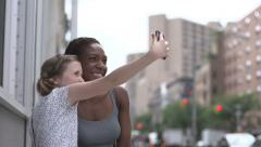 A white tween girl and a black woman take a selfie Stock Footage