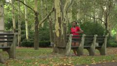 A female African American jogger in park - PB Stock Footage