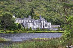 Kylemore Abbey on the lake. - stock photo