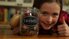 A tween girl saving for the future Stock Footage