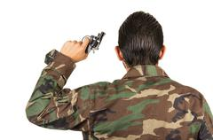 distraught military soldier veteran ptsd holding a gun - stock photo