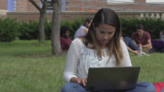 Hispanic female student types on laptop, outside. Stock Footage